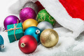 Christmas balls and gifts are scattered on the snow - PhotoDune Item for Sale