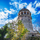 Stunning view of Galata Tower framed by trees - PhotoDune Item for Sale