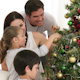 Brother and Sister Decorating a Christmas Tree with Their Parents - VideoHive Item for Sale