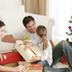 Parents and Daughter Playing with Christmas Presents - VideoHive Item for Sale