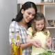 Mother and Daughter Making a Salad - VideoHive Item for Sale