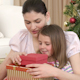 Mother and Daughter Opening Christmas Gifts - VideoHive Item for Sale