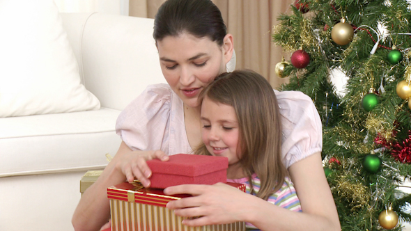 Mother and Daughter Opening Christmas Gifts