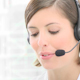 Smiling Woman Working in a Call Center - VideoHive Item for Sale