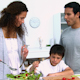 Woman Cooking a Salad With Her Son - VideoHive Item for Sale