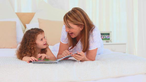 Lovely Lttle Girl Reading A Book