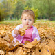Baby Playing With Autumn Leaves - PhotoDune Item for Sale