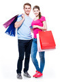 Happy young couple with shopping bags. - PhotoDune Item for Sale