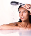 woman holds shower in hands  with falling water - PhotoDune Item for Sale