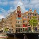City view of Amsterdam canals and typical houses, Holland, Nethe - PhotoDune Item for Sale