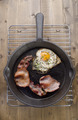 cast iron pan with bacon and fried egg - PhotoDune Item for Sale