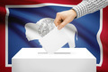 Voting concept - Ballot box with national flag on background - Wyoming - PhotoDune Item for Sale