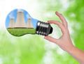 Hand holding bulb with nuclear power plant - PhotoDune Item for Sale