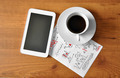 coffee with digital tablet and analytical paper