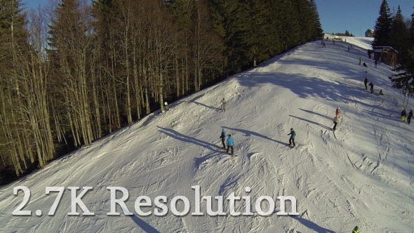 VideoHive Flying over Skiers on Snowy Slope 4 9643812