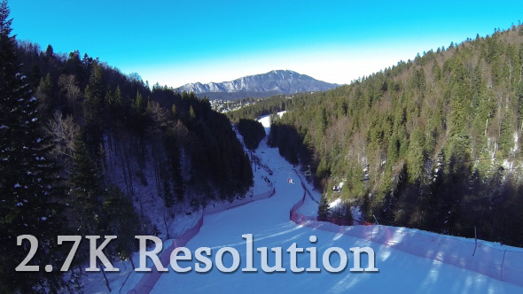 VideoHive Flying over Snowy Winter Slope 9644118