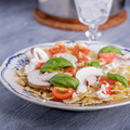 Pasta salad with tomatoes and mushrooms and some basil - PhotoDune Item for Sale