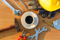 Close up coffee cup and assorted work tools on table - PhotoDune Item for Sale