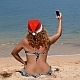 Santa Woman on the Beach Taking Selfie - VideoHive Item for Sale