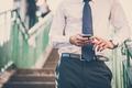 close up businessman man hands using smart phone