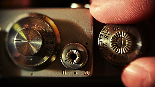 VideoHive Photographer Recharges A Film Camera 9661501