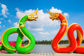 Thai dragon or Naga statue with blue sky background at Thailand - PhotoDune Item for Sale