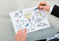 Businessman Drawing Management Chart At Desk - PhotoDune Item for Sale