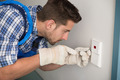 Man Repairing Light Switch At Home - PhotoDune Item for Sale