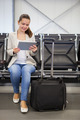Businesswoman Using Digital Tablet At Airport Lobby - PhotoDune Item for Sale