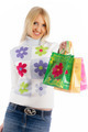 Young smiling woman with shopping bags over white background - PhotoDune Item for Sale