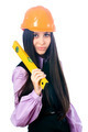 Young female worker with protection helmet and measuring level over isolated background - PhotoDune Item for Sale