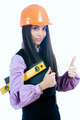 Attractive girl with level shows thumb up gesture - PhotoDune Item for Sale