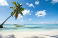 Idyllic Caribbean coastline with boat - PhotoDune Item for Sale