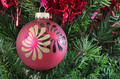 Red Christmas bauble hanging on a tree - PhotoDune Item for Sale