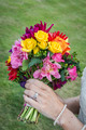 Bride displaying flowers and wedding ring - PhotoDune Item for Sale