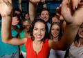 smiling women dancing in club