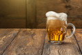 Light beer in mug on wood - PhotoDune Item for Sale