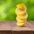 Fresh lemon cuts on wooden table - PhotoDune Item for Sale