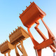 The buckets/shovels of heavy construction machine raised against - PhotoDune Item for Sale