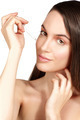 Beautiful model applying a cosmetic skin serum treatment - PhotoDune Item for Sale