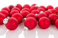Red Christmas balls isolated at a white background - PhotoDune Item for Sale