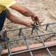 workers are  preparing steel poles for building house - PhotoDune Item for Sale