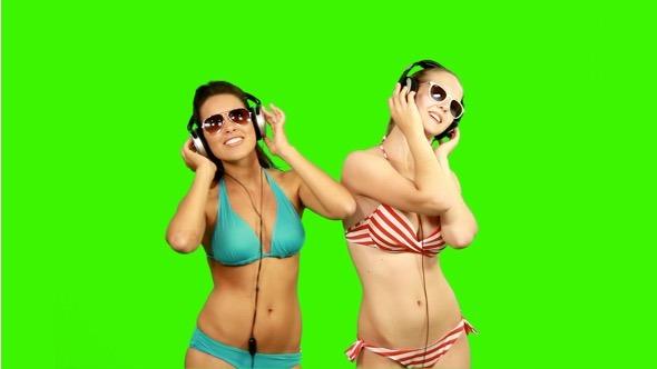 Beautiful Slim Girls Dancing with Headphones