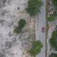 Above a Car in Mountainous Landscape - VideoHive Item for Sale