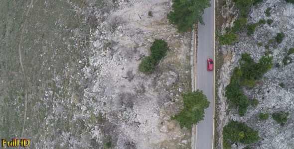 VideoHive Above a Car in Mountainous Landscape 9690119