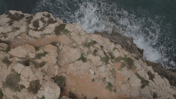 VideoHive Rocky Coast and Sailboat out at Sea Aerial Drone 9693592