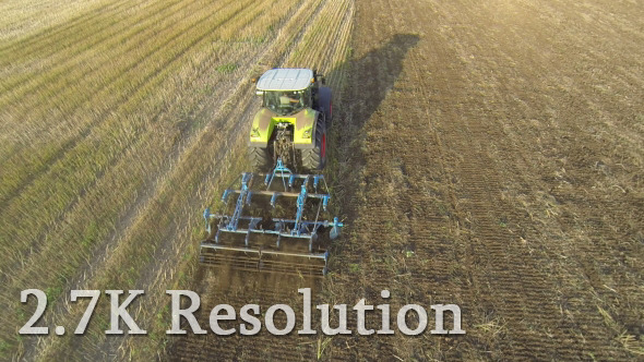 VideoHive Flying over Wheat Field Harvester 2 9693776
