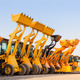 The row of heavy construction excavator machine  against blue sk - PhotoDune Item for Sale