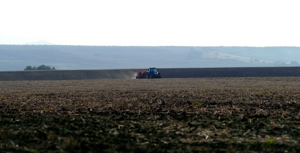 VideoHive Plowing the Fields with a Tractor 9701293