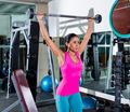 brunette girl wide grip barbell shoulder press gym - PhotoDune Item for Sale